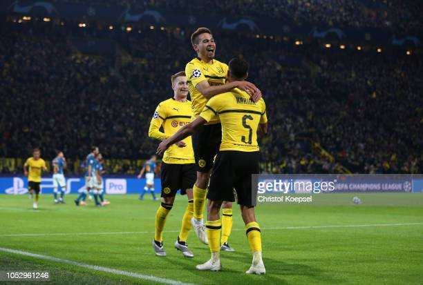 Raphael Guerreiro of Borussia Dortmund celebrates with team mates after scoring their team's second goal during the Group A match of the UEFA...