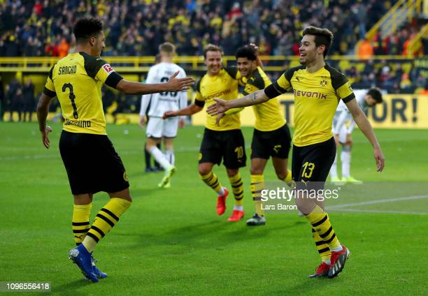 Raphael Guerreiro of Borussia Dortmund celebrates with teammate Jadon Sancho after scoring his team's third goal during the Bundesliga match between...