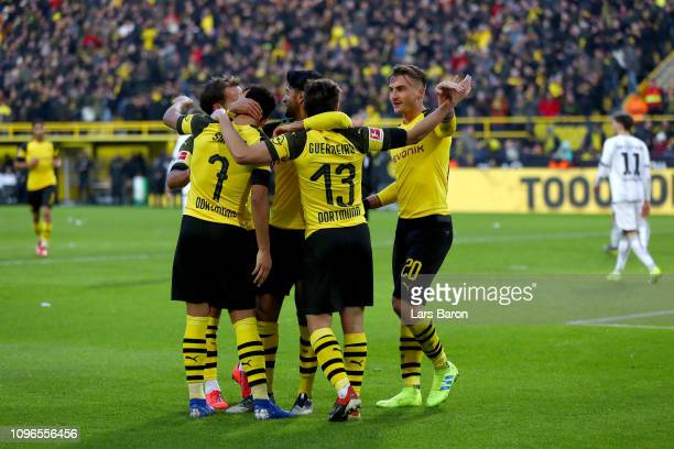 Raphael Guerreiro of Borussia Dortmund celebrates with teammates after scoring his team's third goal during the Bundesliga match between Borussia...
