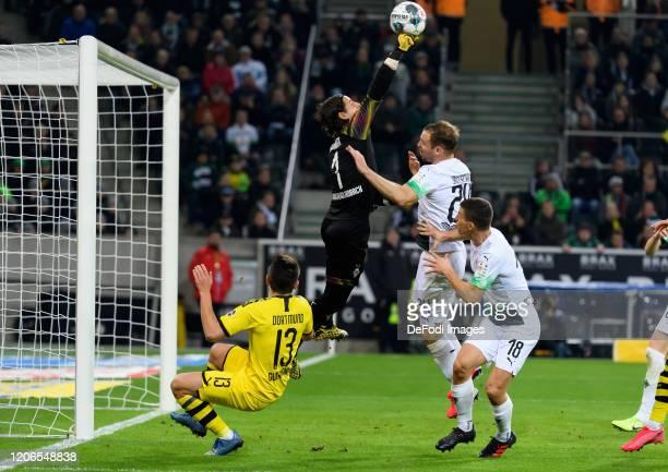 Raphael Guerreiro of Borussia Dortmund goalkeeper Yann Sommer of Borussia Moenchengladbach Tony Jantschke of Borussia Moenchengladbach and Stefan...