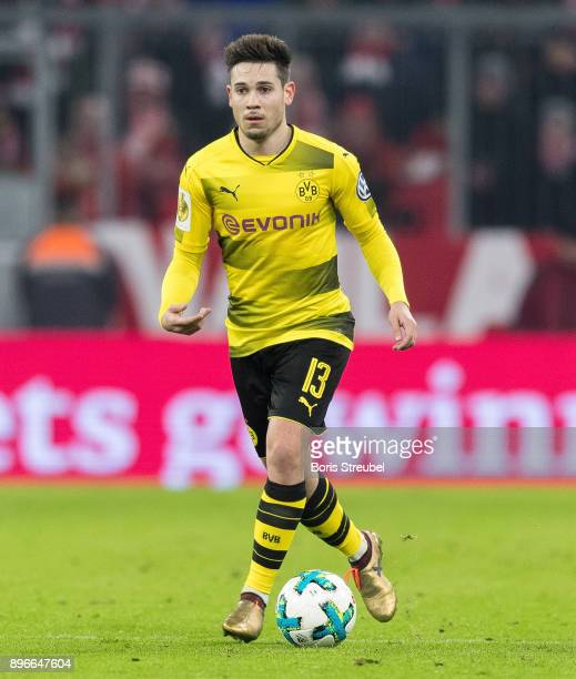 Raphael Guerreiro of Borussia Dortmund runs with the ball during the DFB Cup match between Bayern Muenchen and Borussia Dortmund at Allianz Arena on...