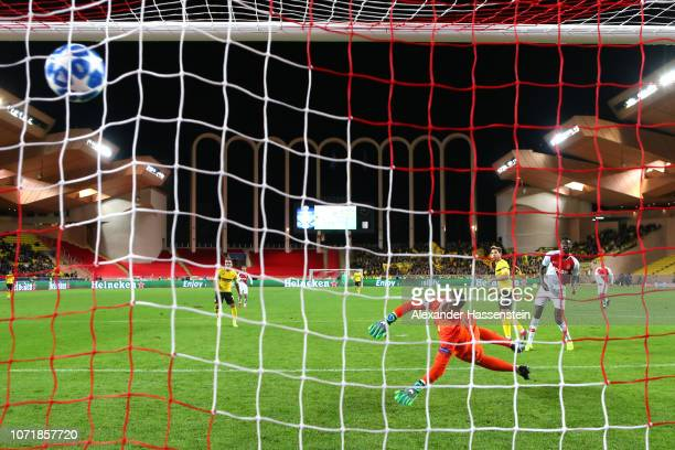 Raphael Guerreiro of Borussia Dortmund scores his team's second goal past goalkeeper Diego Benaglio of Monaco during the UEFA Champions League Group...
