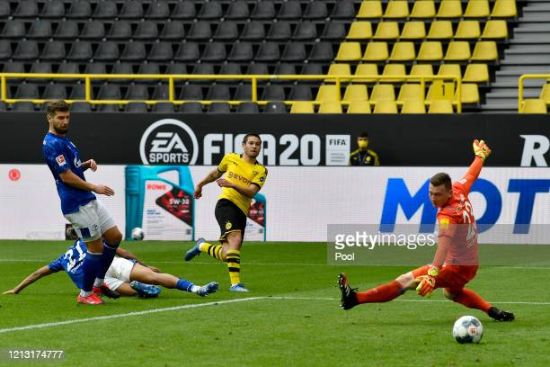 Raphael Guerreiro of Borussia Dortmund shoots and scores his side's second goal during the Bundesliga match between Borussia Dortmund and FC Schalke...