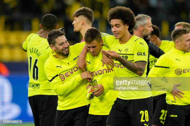 Raphael Guerreiro of Borussia Dortmund, Thorgan Hazard of Borussia Dortmund and Axel Witsel of Borussia Dortmund looks on after the UEFA Champions...