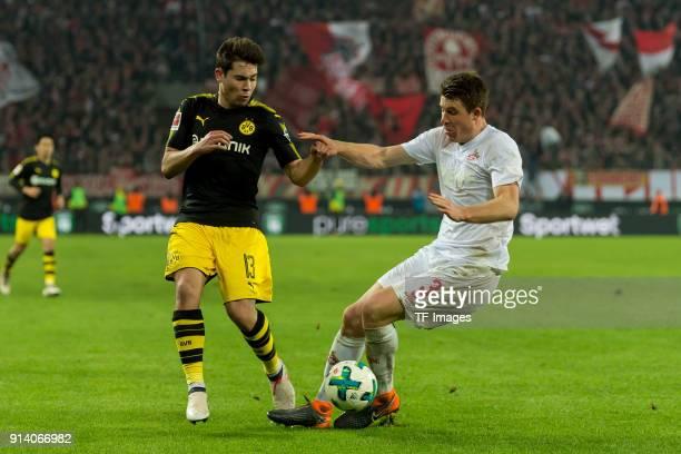 Raphael Guerreiro of Dortmund and Dominique Heintz of Koeln battle for the ball during the Bundesliga match between 1 FC Koeln and Borussia Dortmund...