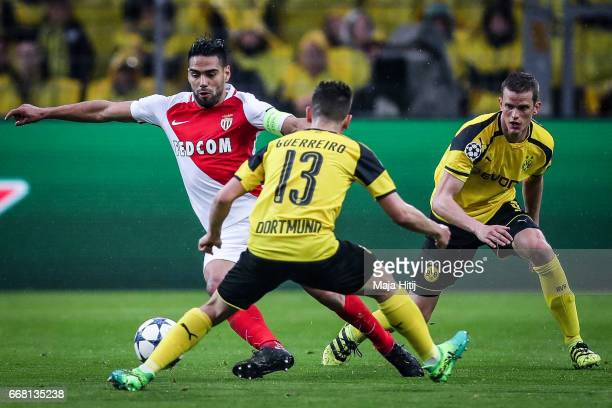 Raphael Guerreiro of Dortmund and Falcao of Monaco battle for the ball during the UEFA Champions League Quarter Final first leg match between...