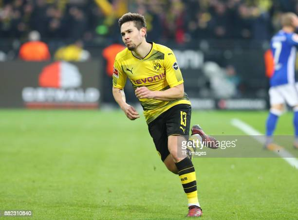 Raphael Guerreiro of Dortmund celebrates after scoring his team`s fourth goal during the Bundesliga match between Borussia Dortmund and FC Schalke 04...