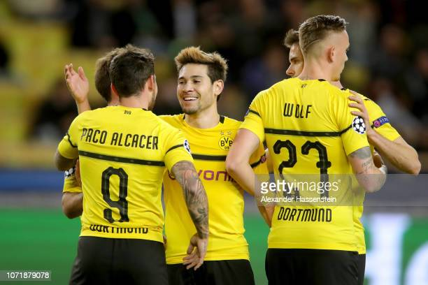Raphael Guerreiro of Dortmund celebrates scoring the 2nd team goal with his team mates during the UEFA Champions League Group A match between AS...
