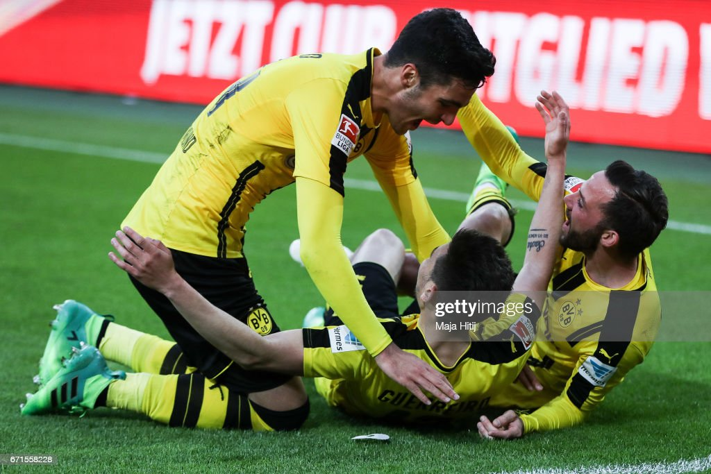 Raphael Guerreiro of Dortmund (C) celebrates with his team-mates after scoring his team's third goal during the Bundesliga match between Borussia Moenchengladbach and Borussia Dortmund at Borussia-Park on April 22, 2017 in Moenchengladbach, Germany.