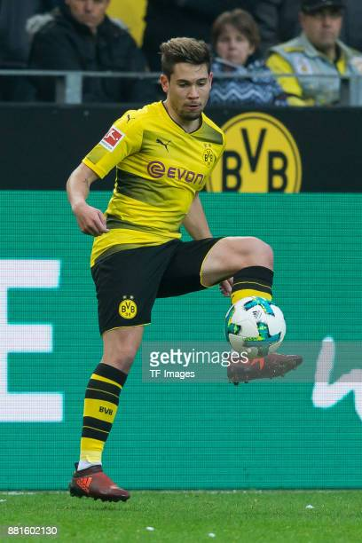 Raphael Guerreiro of Dortmund controls the ball during the Bundesliga match between Borussia Dortmund and FC Schalke 04 at Signal Iduna Park on...