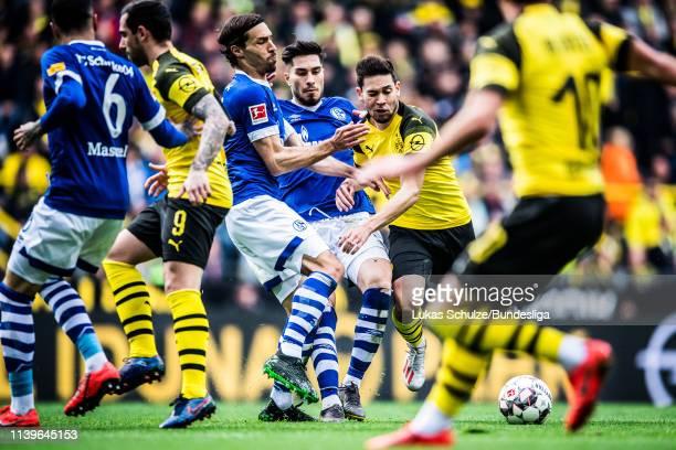 Raphael Guerreiro of Dortmund in action with Benjamin Stambouli and Suat Serdar during the Bundesliga match between Borussia Dortmund and FC Schalke...