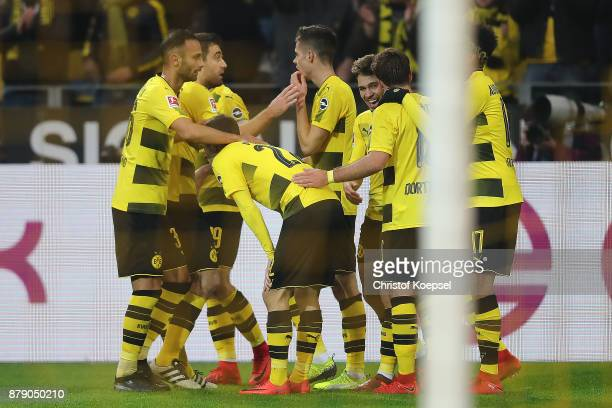 Raphael Guerreiro of Dortmund is celebrated by his team after he scored a goal to make it 40 during the Bundesliga match between Borussia Dortmund...