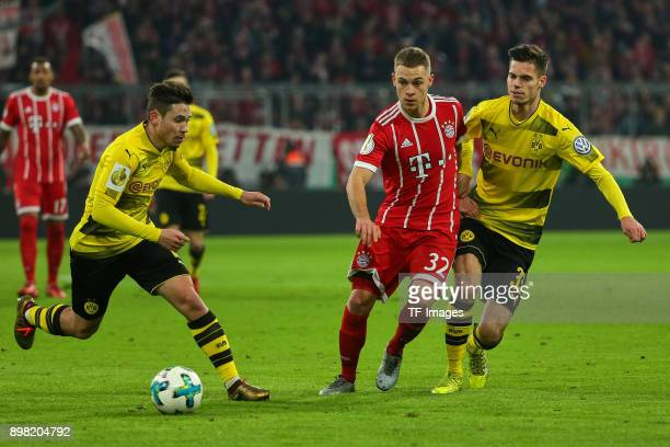 Raphael Guerreiro of Dortmund Julian Weigl of Dortmund and Joshua Kimmich of Muenchen battle for the ball during the DFB Cup match between Bayern...
