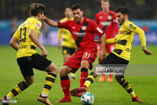 Raphael Guerreiro of Dortmund Kevin Volland of Bayer Leverkusen and Nuri Sahin of Dortmund fight for the ball during the Bundesliga match between...