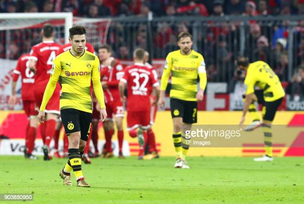Raphael Guerreiro of Dortmund Marcel Schmelzer of Dortmund and Oemer Toprak of Dortmund look dejected during the DFB Cup match between Bayern...