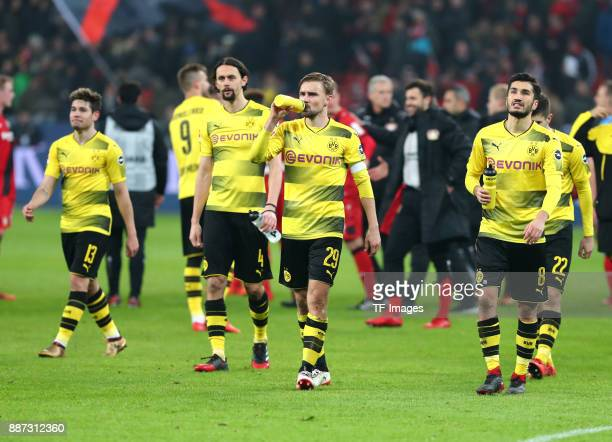 Raphael Guerreiro of Dortmund Neven Subotic of Dortmund Marcel Schmelzer of Dortmund and Nuri Sahin of Dortmund look dejected after the Bundesliga...