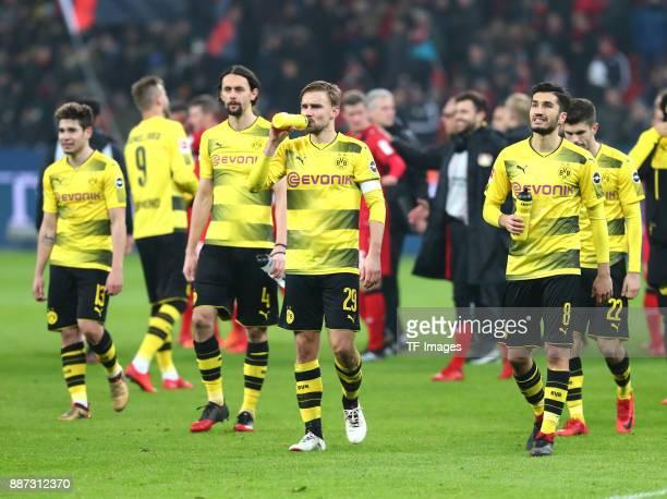 Raphael Guerreiro of Dortmund Neven Subotic of Dortmund Marcel Schmelzer of Dortmund Nuri Sahin of Dortmund and Christian Pulisic of Dortmund look...