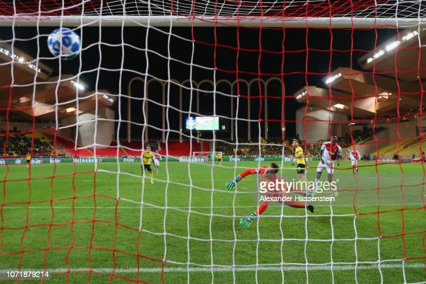 Raphael Guerreiro of Dortmund scores the 2nd team goal against Diego Benaglio keeper of Monaco during the UEFA Champions League Group A match between...
