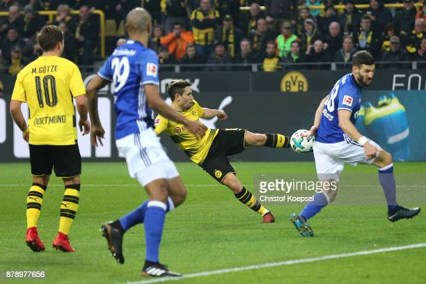 Raphael Guerreiro of Dortmund shoots to score a goal to make it 30 during the Bundesliga match between Borussia Dortmund and FC Schalke 04 at Signal...