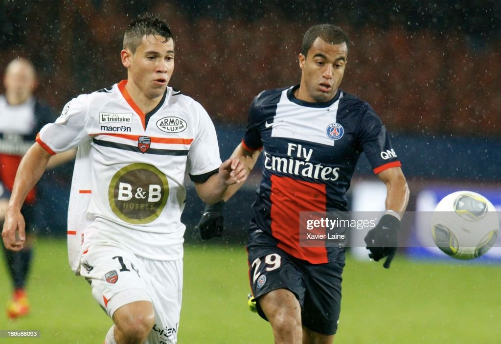 Raphael Guerreiro of Lorient FC and Lucas of Paris Saint-Germain during the French League 1 between Paris Saint-Germain FC and Lorient FC, at Parc des Princes on November 1, 2013 in Paris, France.