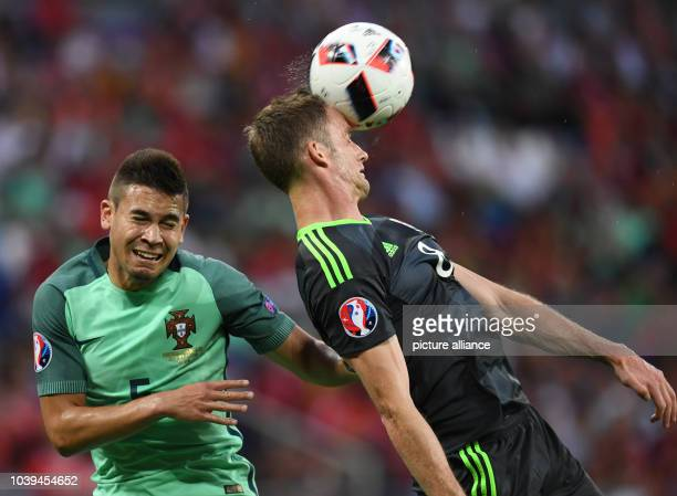 Raphael Guerreiro of Portugal and Andy King of Wales vie for the ball during the UEFA EURO 2016 semi final soccer match between Portugal and Wales at...