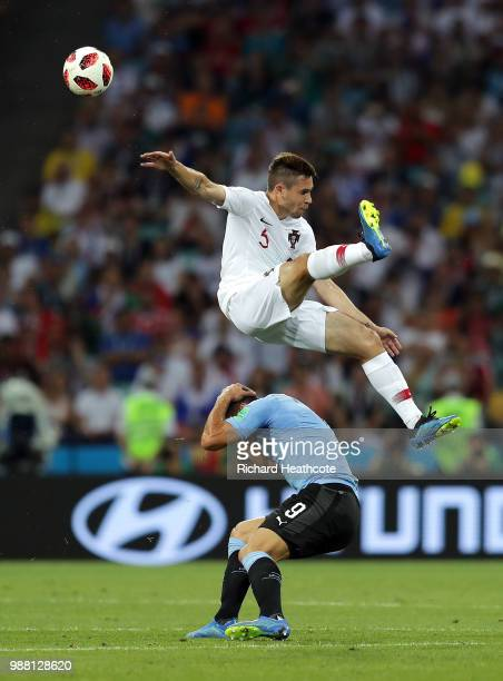 Raphael Guerreiro of Portugal and Luis Suarez of Uruguay clash during the 2018 FIFA World Cup Russia Round of 16 match between Uruguay and Portugal...
