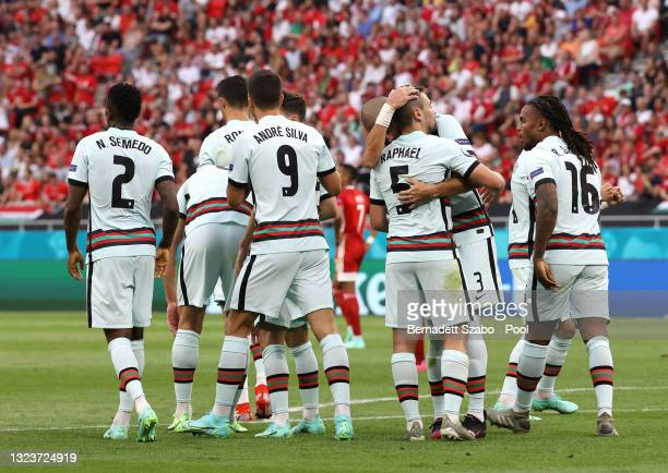 Raphael Guerreiro of Portugal celebrates with Pepe and team mates after scoring their side's first goal during the UEFA Euro 2020 Championship Group...