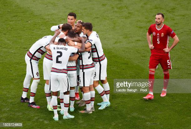 Raphael Guerreiro of Portugal celebrates with team mates after scoring their side's first goal during the UEFA Euro 2020 Championship Group F match...