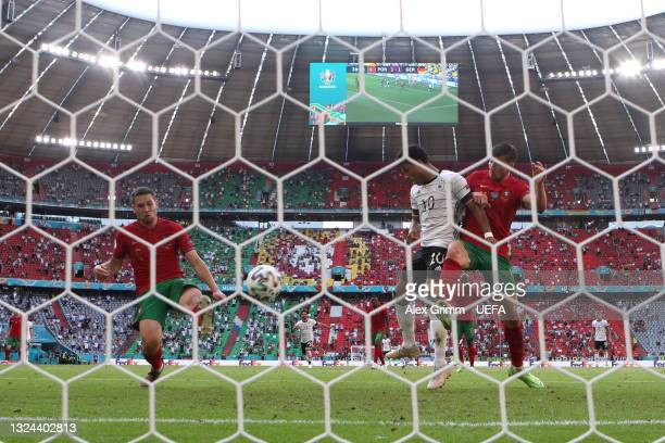 Raphael Guerreiro of Portugal scores an own goal for Germany's second goal during the UEFA Euro 2020 Championship Group F match between Portugal and...