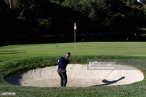 Raphael Jacquelin of France hits his second shot on the 11th hole out of the bunker during Day 1 of the Open de Espana held at PGA Catalunya Resort...