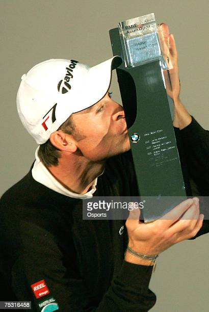 Raphael Jacquelin of France kisses the champion trophy after winning the 2007 BMW Asian Open, final round at Tomson Shanghai Pudong Golf Club,...