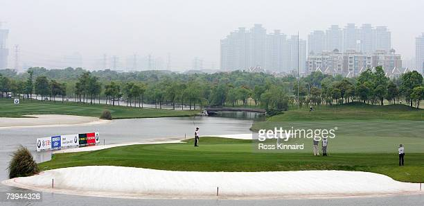 Raphael Jacquelin of France putting on the par five 9th hole during the final round of the BMW Asian Open at the Tomson Shanghai Pudong Golf Club on...