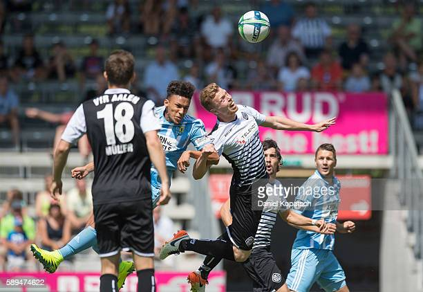 Raphael Jamil Dem of Chemnitz jumps for a header with Fabian Bernhardt of Aalen during the third league match between VfR Aalen and Chemnitzer FC at...