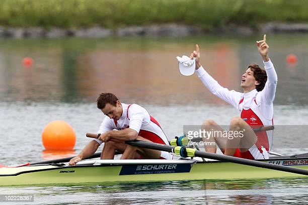 Raphael Jeanneret and Simon Schuerch of Switzerland celebrate after winning the men's lightweight pairs final during the FISA Rowing World Cup on...