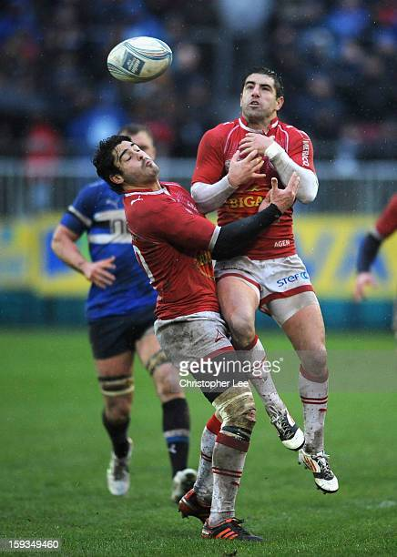 Raphael Lagarde and Alexis Bales of Agen jump into each other as they go for the ball during the Amlin Challenge Cup Pool 4 Round 5 match between...