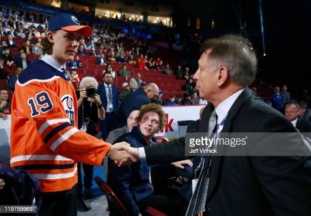 Raphael Lavoie 38th overall pick of the Edmonton Oilers is greeted by head coach Ken Holland of the Edmonton Oilers during Rounds 27 of the 2019 NHL...