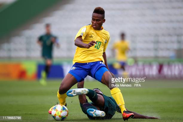 Raphael Leai of Solomon Islands struggles for the ball with Franco Tongya of Italy during the FIFA U17 Men's World Cup Brazil 2019 group F match...