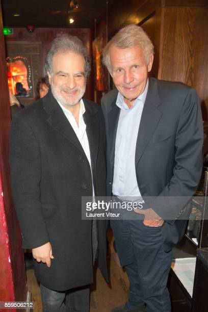 Raphael Mezrahi and Patrick Poivre D'Arvor attend 'Carnets d'un Sale Gosse' Laurent Gerra Signing his book at Buddha Bar on October 9 2017 in Paris...