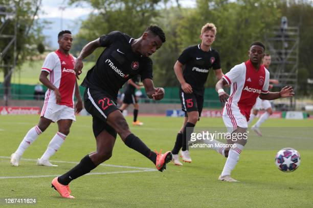 Raphael Nwadike of Midtjylland clears the ball during the UEFA Youth League Quarter Final match between Midtylland v Ajax at Colovray Sports Centre...