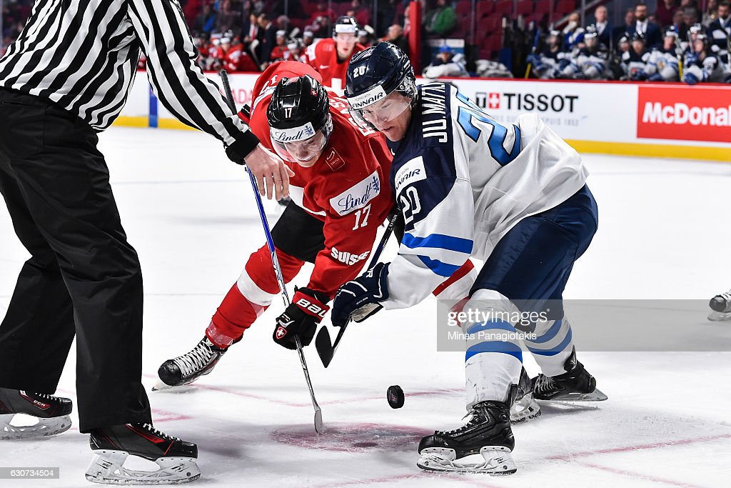 Raphael Prassl #17 of Team Switzerland and Julius Mattila #20 of Team Finland face-off during the 2017 IIHF World Junior Championship preliminary round game at the Bell Centre on December 31, 2016 in Montreal, Quebec, Canada.