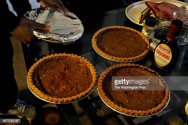 Raphael Richmond made some pies with the yams she received from a local church food bank Her son Anthony wrapped them in foil to store them in the...