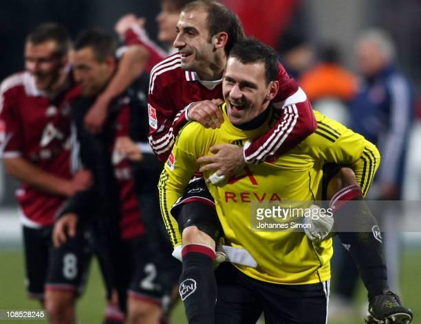 Raphael Schaefer goalkeeper of Nuernberg and teammate Javier Pinola celebrate after the Bundesliga match between 1 FC Nuernberg and Hamburger SV at...