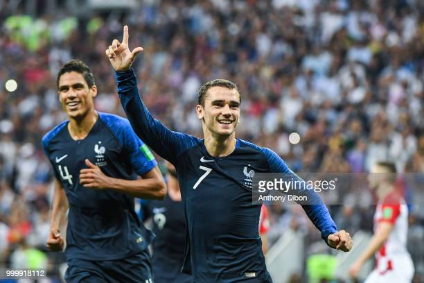 Raphael Varane and Antoine Griezmann celebrate a goal during the World Cup Final match between France and Croatia at Luzhniki Stadium on July 15 2018...