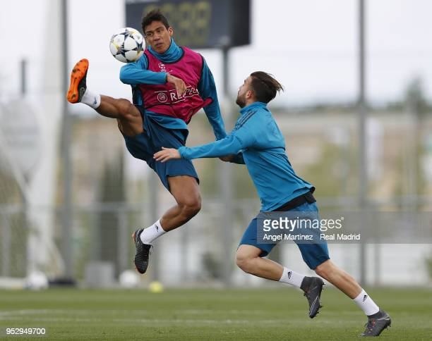 Raphael Varane and Borja Mayoral of Real Madrid in action during a training session at Valdebebas training ground on April 30 2018 in Madrid Spain