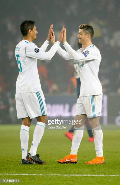 Raphael Varane and Cristiano Ronaldo of Real Madrid celebrate the victory following the UEFA Champions League Round of 16 Second Leg match between...