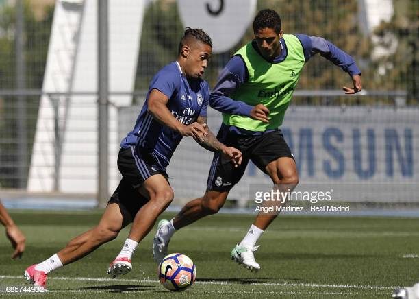 Raphael Varane and Mariano Diaz of Real Madrid in action during a training session at Valdebebas training ground on May 20 2017 in Madrid Spain