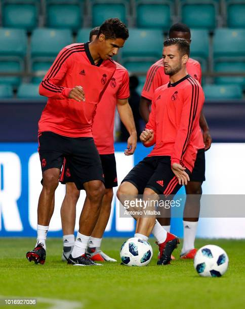 Raphael Varane and Nacho Fernandez of Real Madrid during a training session at A Le Coq Arena on August 14 2018 in Tallinn Estonia