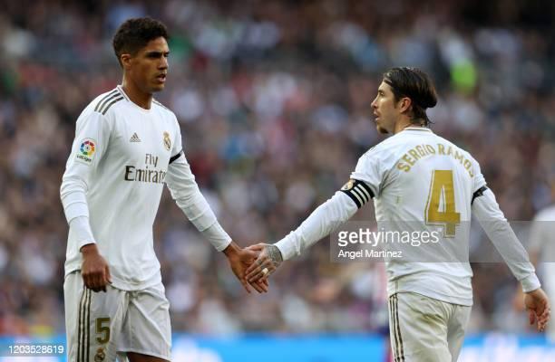 Raphael Varane and Sergio Ramos of Real Madrid shake hands during the Liga match between Real Madrid CF and Club Atletico de Madrid at Estadio...