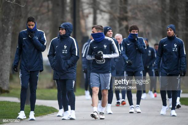 Raphael Varane Antoine Griezmann and Lucas Digne of France during a training session at Centre National du Football on March 19 2018 in...