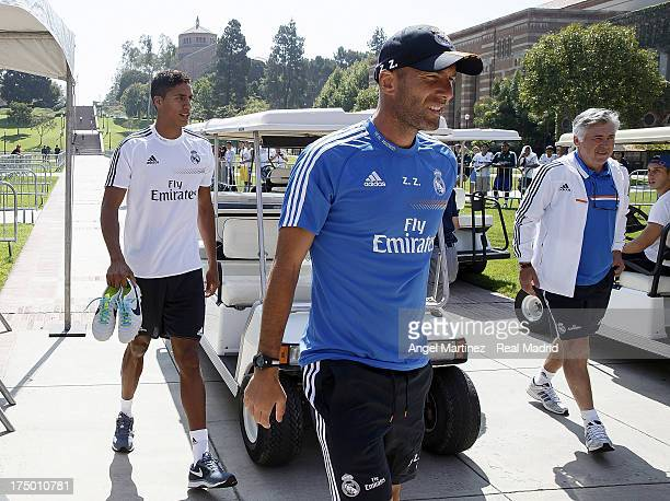 Raphael Varane assistant coach Zinedine Zidane and head coach Carlo Ancelotti of Real Madrid arrive to the training ground before a training session...